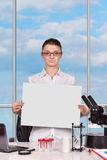 Female scientific researcher holding blank poster Royalty Free Stock Photo