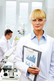 Female scientist. Looking at camera at laboratory Royalty Free Stock Photography