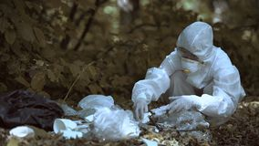 Female scientist analyzing garbage in forest, plastic pollution problem, climate. Stock footage stock footage