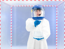 Female scientist carrying a jar of toxic liquid stock photo