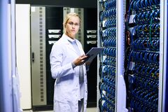 Female Scientist in Data Center Royalty Free Stock Image