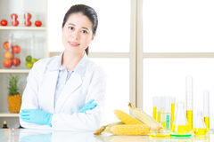 Female scientist develop and test all of genetic modification food. Are safe stock images