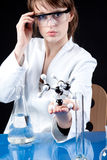 Female Scientist experimenting Stock Photo