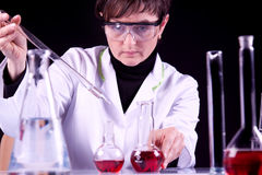 Female Scientist experimenting Stock Photos
