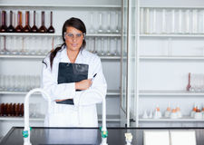 Female scientist holding a clipboard Royalty Free Stock Photos