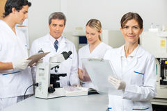 Female Scientist Holding Clipboard In Laboratory Stock Photography