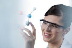 Female scientist holding molecular model Royalty Free Stock Photos
