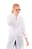 Female scientist looking through finger's hole. Young adult caucasian woman isolated on a white background Stock Image