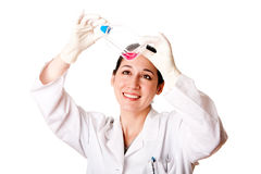 Female scientist looking at tissue culture flask Stock Image