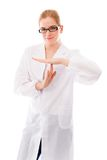 Female scientist making time out signal with hands Royalty Free Stock Photo