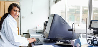 Female scientist with a monitor Stock Images