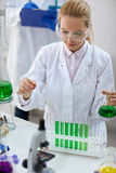 Female scientist with pipette and tubes making test Stock Images