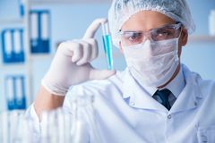 Female scientist researcher conducting an experiment in a labora Stock Photos