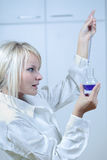 Female scientist/researcher in a lab. Closeup of a female researcher carrying out experiments in a lab Stock Photos