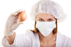 Female Scientist Showing an Egg. Closeup of Female Scientist Showing an Egg Royalty Free Stock Photography