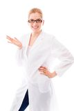 Female scientist standing with her hand on hip and gesturing Royalty Free Stock Photos