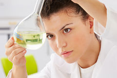 Female Scientist Studying Liquid In Flask. With Here Hands Royalty Free Stock Photos