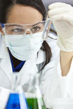 Female Scientist With Test Tube In Laboratory Stock Photography