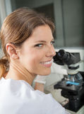 Female Scientist Using Microscope In Lab Royalty Free Stock Image