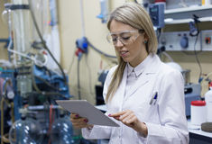 Female scientist using tablet computer in the lab Stock Images