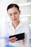 Female Scientist Using Tablet  In Laboratory Royalty Free Stock Images