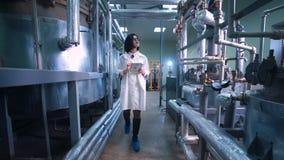 Female scientist walking through lab stock footage