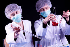 Female Scientists experimenting Royalty Free Stock Photo