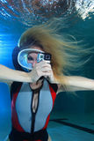Female scuba diver with action camera Stock Photography