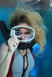 Female scuba diver with action camera Royalty Free Stock Image