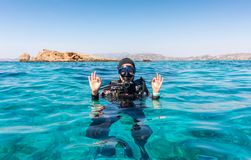 The OK sign by a female scuba diver royalty free stock image