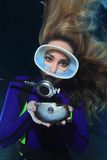 Female scuba diver pearl. Female scuba diver and shell with pearl royalty free stock photo