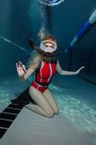 Female scuba diver with red swimsuit Stock Photography