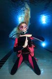 Female scuba diver. Show underwater signal Stock Images