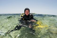 Female scuba diver on surface Stock Photo