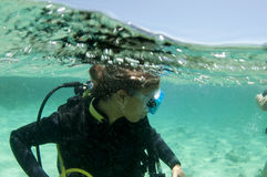 Female scuba diver on the surface. Just after a dive Royalty Free Stock Photos