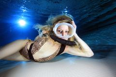 Female scuba diver. Underwater in the pool Royalty Free Stock Image