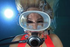Female scuba diver. Underwater with water inside mask Stock Photo