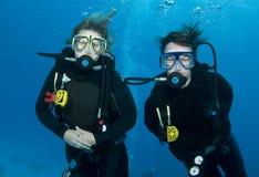 Female scuba divers Stock Images