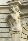 Female sculpture as decoration of the facade. Of the old building Stock Photography