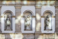 Female sculpture in the niches of the wall. Vein. Austria stock photography