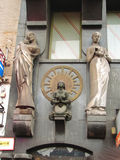 Female sculptures on the facade of a building in  Amsterdam . Ne Royalty Free Stock Photography