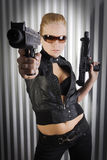 Female secret agent. Pretty women playing secraet agent holding guns Royalty Free Stock Photo