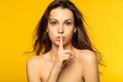 Female secret mystery girl finger on lips gesture royalty free stock images