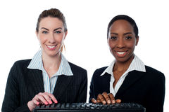 Female secretaries typing in keyboard Stock Photo