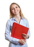 Female secretary with colorful paperwork laughing at camera Royalty Free Stock Photos