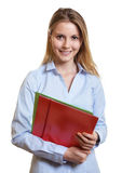 Female secretary with colorful paperwork Royalty Free Stock Image