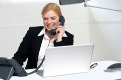 Female secretary communicating with her boss. On phone in the office stock image