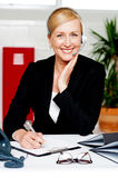 Female secretary confirming appointment Royalty Free Stock Photography