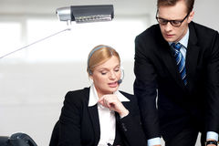 Female secretary explaining to boss Royalty Free Stock Photography