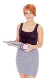 Female secretary holding a file folder Royalty Free Stock Images
